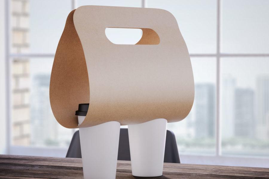 Accesorio en cartón kraftliner para transporte múltiple de vasos con líquido.